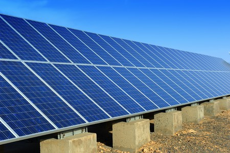 electric generating plant: solar panel with desert house