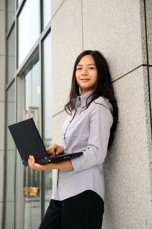 beautiful asian businesswoman working on her laptop outdoor  Stock Photo - 8310384