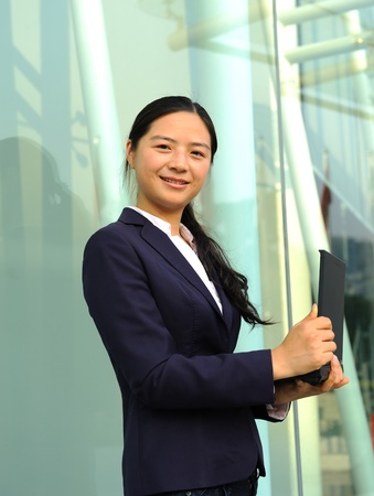 beautiful asian businesswoman working on her laptop outdoor Stock Photo - 8944199