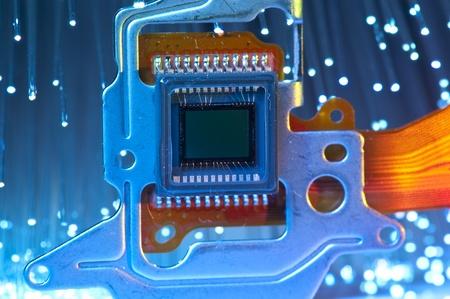 CCD sensor on a card of digital camera with fiber optical background  photo