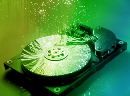 harddisk isolated on with fiber optical background   photo