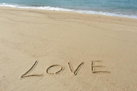 carta de amor: te amo en la arena  Foto de archivo