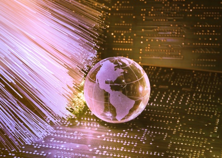 telecomm: electronic printed circuit board with technology style against fiber optic background   Stock Photo