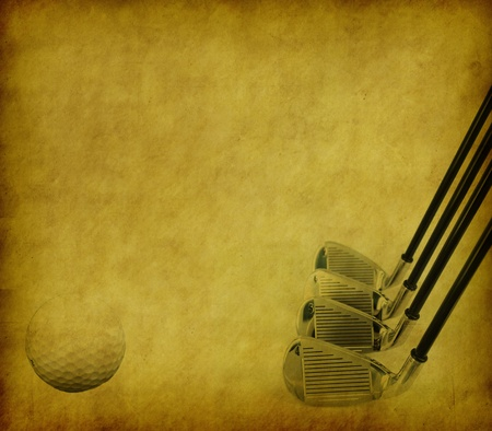 Golf Clubs and Balls on Grunge Abstract Background photo