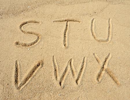 alphabet letters  handwritten in sand on beach Stock Photo - 10048755