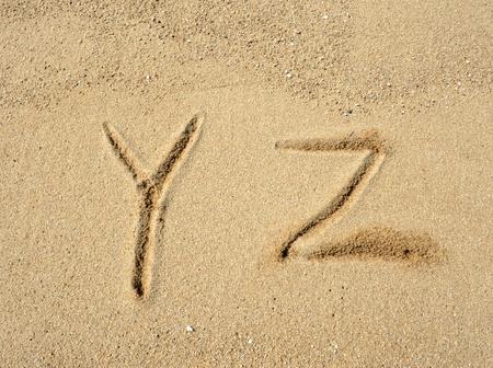 alphabet letters  handwritten in sand on beach Stock Photo - 10048754