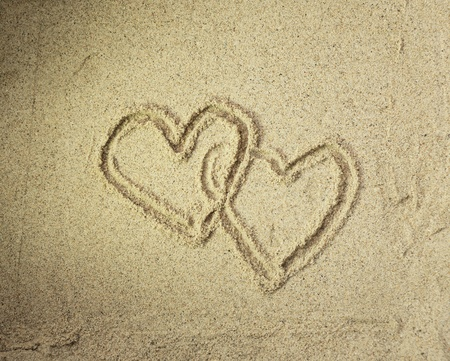 two hearts drawn in beach in sunset Stock Photo - 10867746