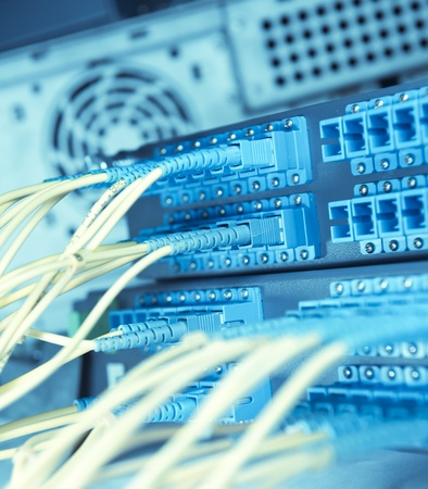 telecommunications equipment: shot of network cables and servers in a technology data center