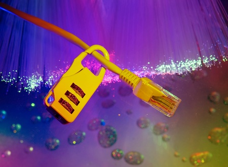 Lock and network cable with computer keyboard background Stock Photo - 9272841