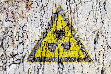radioactivity symbol on abstract rough grunge brick wall background Stock Photo - 9369724