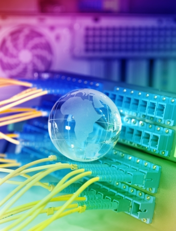 globe with network cables and servers in a technology data center Stock Photo