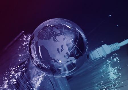 technology earth globe against fiber optic background photo