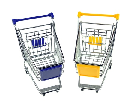 gift box with shopping carts over white background  photo