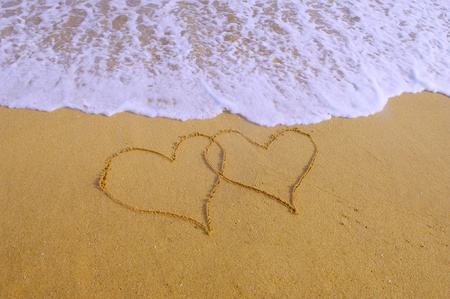 two hearts drawn in beach Stock Photo - 9775779