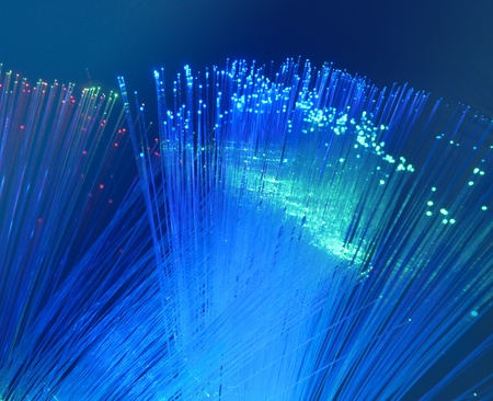 bunch of optical fibres dinamic flying from deep on technology background Stock Photo - 9773375