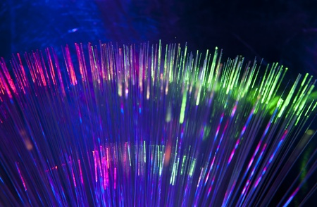 bunch of optical fibres dinamic flying from deep on technology background Stock Photo - 9765787