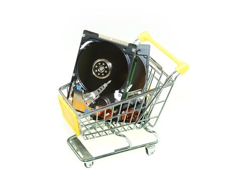shoppingcart: Computer hard disk in ship cart