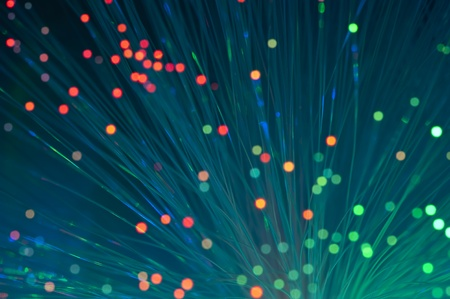 bunch of optical fibres dinamic flying from deep on technology background 