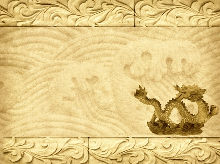 dynasty: Stock image of stone carving of dragon on the wall.