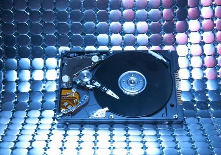 harddisk isolated on with fiber optical background   photo