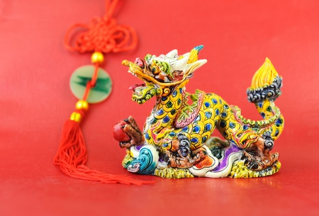 Chinese style dragon statue with red background photo