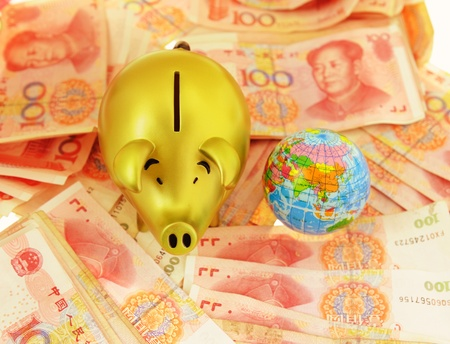 Piggy bank and money on money background photo
