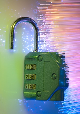 Lock and network cable with computer keyboard background  photo