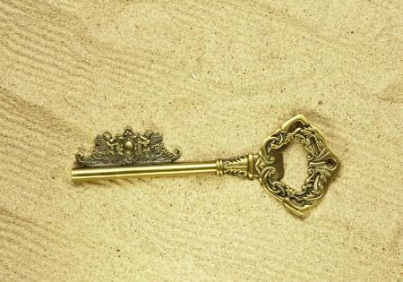 key on sand photo