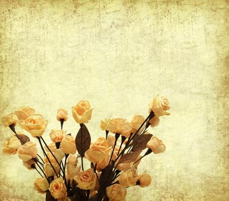 rose on Old antique vintage paper background  photo