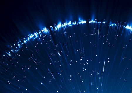 photon: bunch of optical fibres dinamic flying from deep on technology background