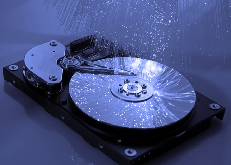 harddisk: computer harddisk and heads on technology fiber optics background