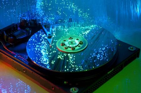 databank: harddisk with fiber optical background more in my portfolio