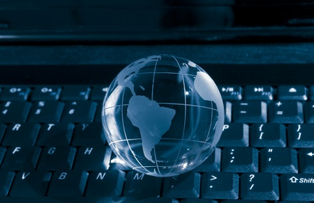 technology earth globe against fiber optic background photo