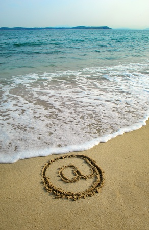 Email symbol draw on beach photo