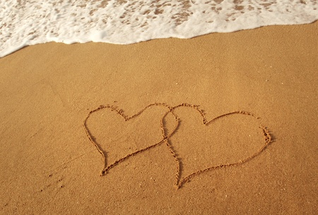 heart in sand: two hearts drawn in beach in sunset