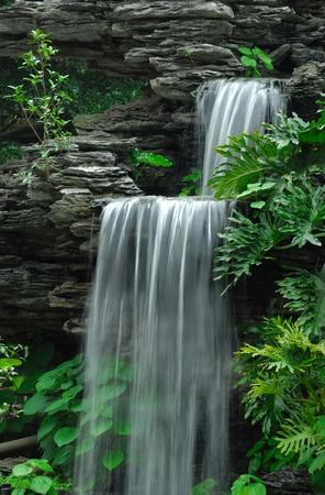 cascade mountains: Autumn waterfall is beautiful  Stock Photo