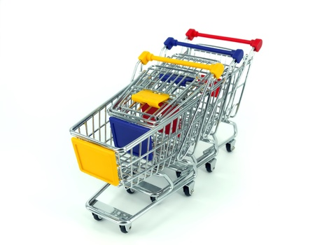 shopping trolleys: shopping cart over white background
