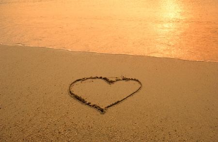 hearts drawn in beach    photo