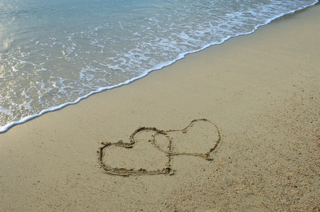 two hearts drawn in beach Stock Photo - 11519437
