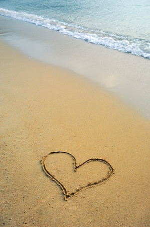 heart drawn in beach photo