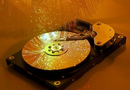 harddisk: harddisk isolated on with fiber optical background   Stock Photo