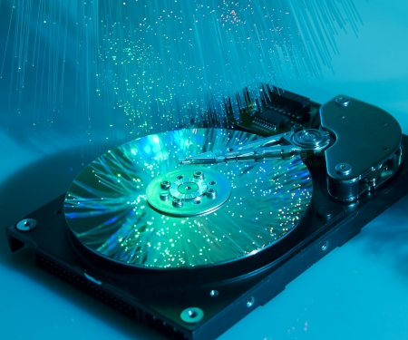 storage disk: Computer hard drives with technology fiber optics background