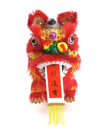 lion dance: traditional dancing lion isolated on white.