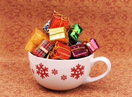 Christmas gift and cup on Vintage christmas background photo