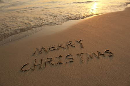 beach happy new year: Merry Christmas handwritten in sand on a beautiful beach