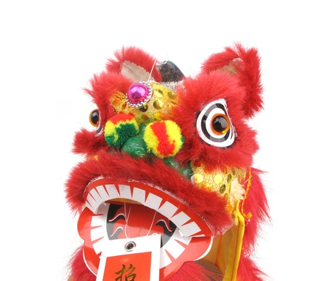 the red dragon: traditional dancing lion isolated on white.