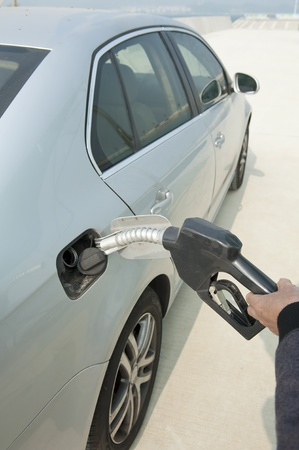fueling pump: fill up fuel at gas station  Stock Photo