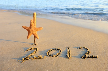 2012 new year message on the sand beach with starfish  photo