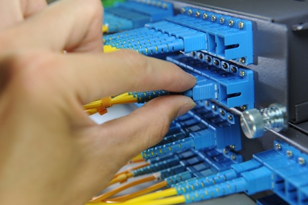 hub: network hub and patch cables,Fiber cables connected to servers in a datacenter( Stock Photo