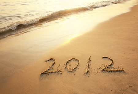 happy new year 2012 on the beach of sunrise Stock Photo - 11870003